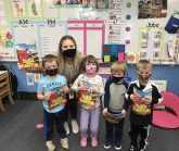 Preschoolers with donated books